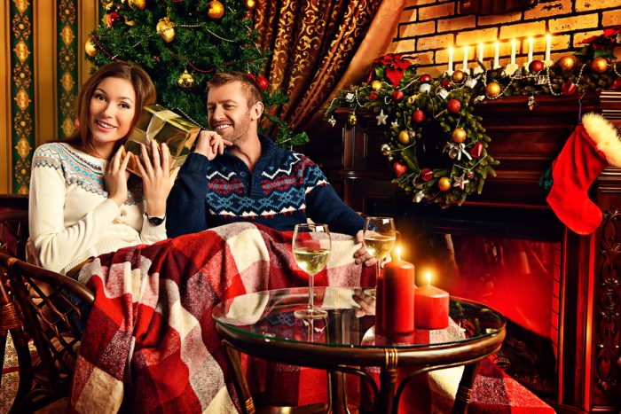 couple-sitting-by-the-fire-on-christmas-1