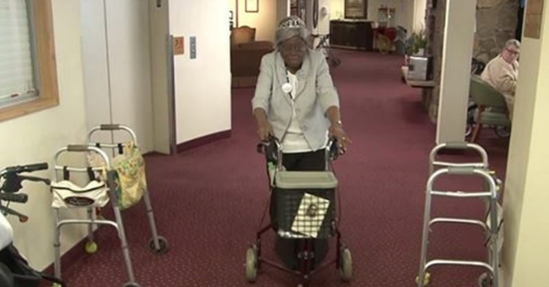 Image of 100 year old celebrates her birthday by running down the hall