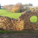 Former Bricklayer Uses Stones to Create Stunning Art Walls