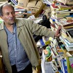 The Lord of the Books: Bibliophile trash collector Saves 25,000 Books and Creates a Free Library