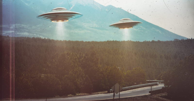 UFOs flying over a road